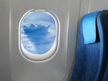 چرا پنجرههای هواپیما دایرهای شکل هستند؟